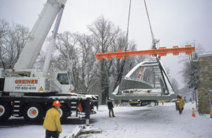 Workers installing a pedestrian bridge with Greiner's 200-ton and 150-ton mobile cranes