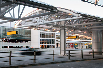 Architecturally exposed structural steel pipe trusses at an airport