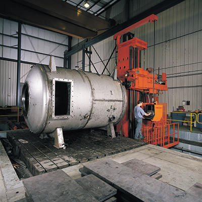 Worker fabricating a pressure vessel at a Greiner facility