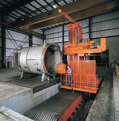 Worker operating a horizontal boring mill at a Greiner facility