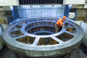 Worker operating Greiner's custom-built vertical turning center